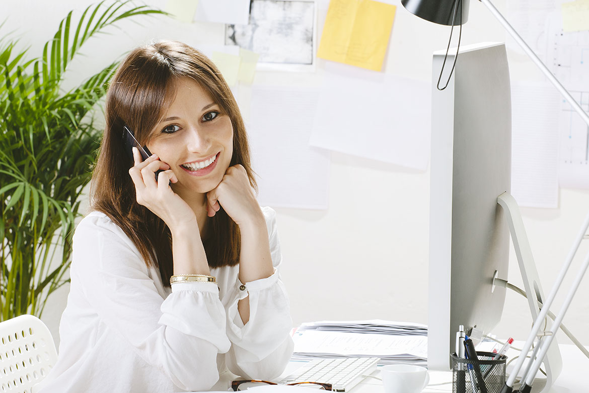 Young businesswoman smiling with a smartphone.